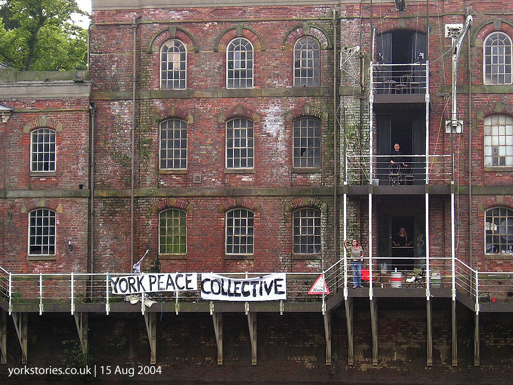 Victorian riverside warehouse with banners