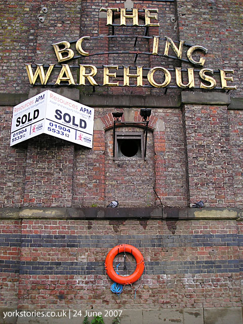 Dilapidated warehouse, with 'Sold' sign