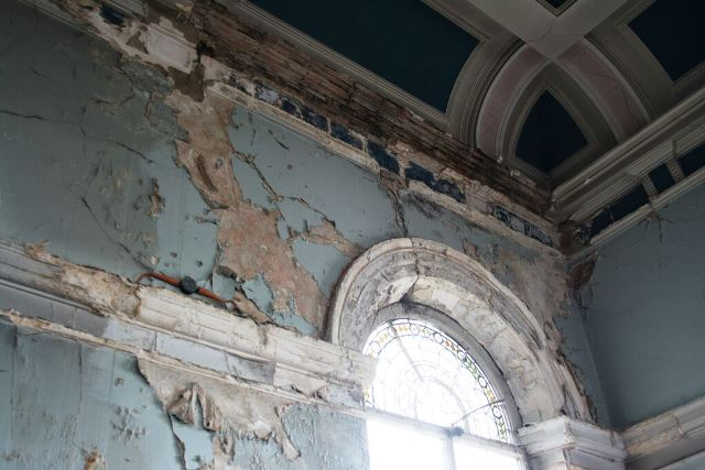 Interior of 19th century chapel, peeling paintwork