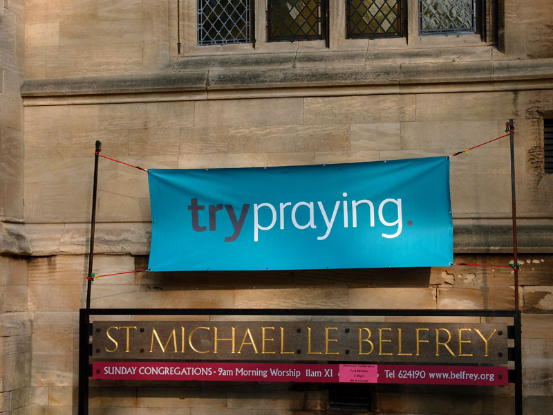 Sign on St Michael le Belfrey, York, May 2015: 'Try praying'