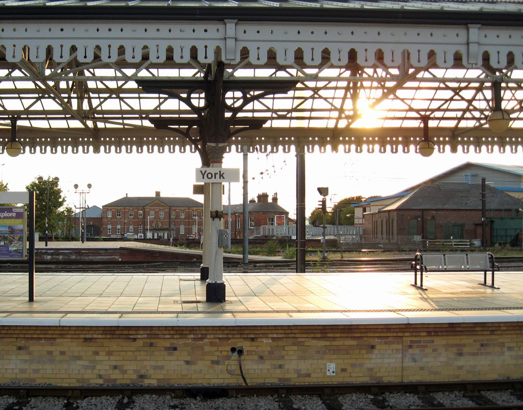 View across station platform, at sunset