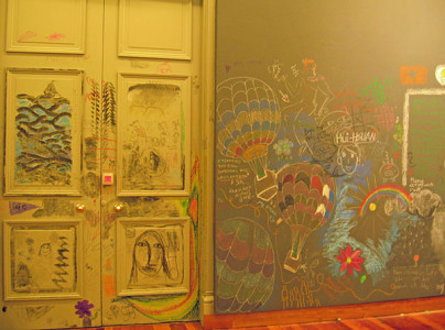 Colourful drawing and writing on walls and door