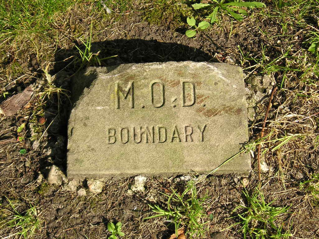 M.O.D boundary stone, in the verge outside Duncombe Barracks, Burton Stone Lane