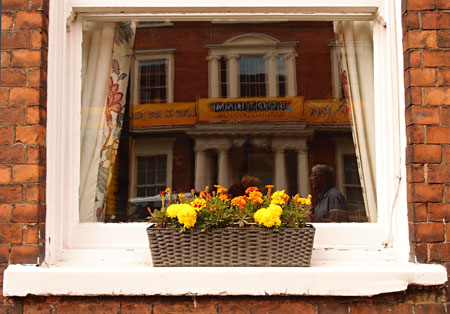 Window box with yellow and orange flowers