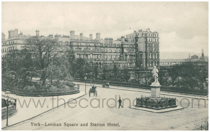Old postcard, city street with statue