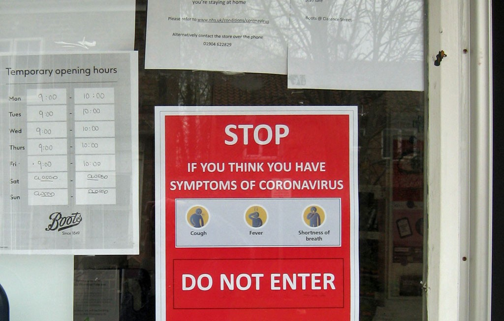 Coronavirus sign, door of chemist's