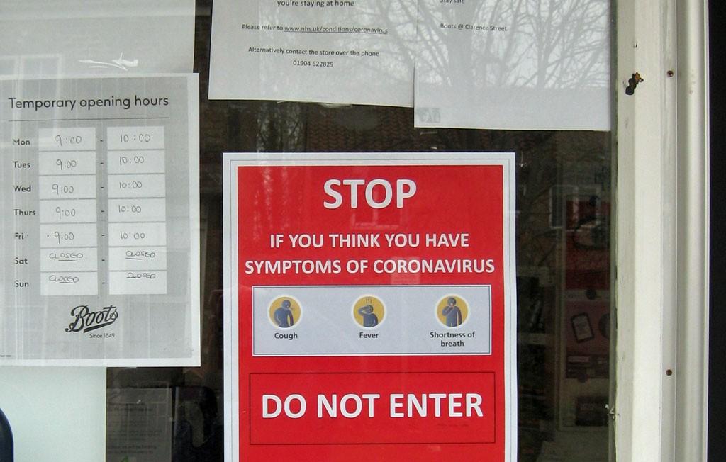 Coronavirus sign, door of chemist's