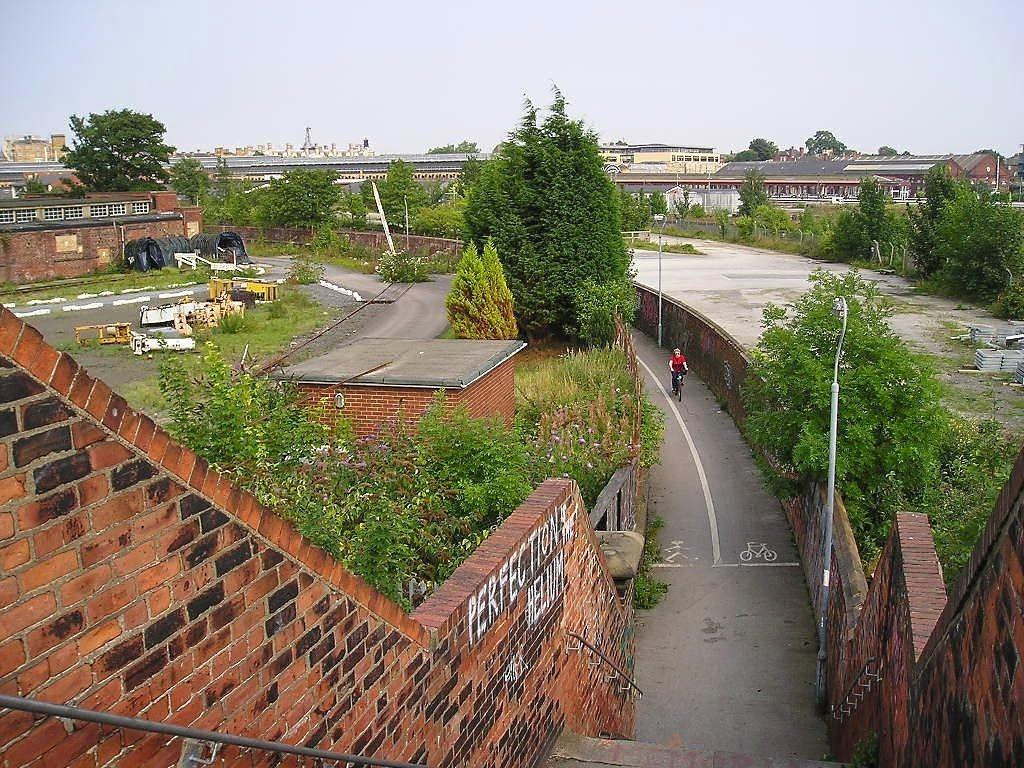Curving pathway between brick walls
