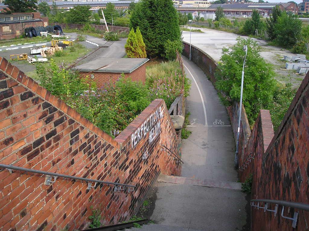 Alley through industrial land