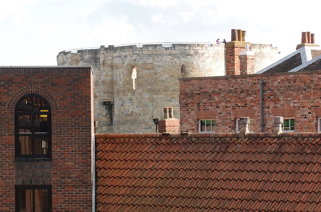 Clifford's Tower across rooftops