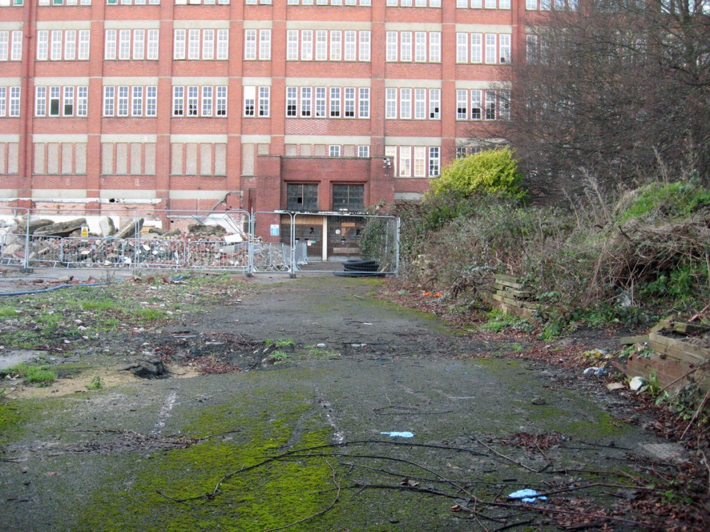 Factory building and rubble in front