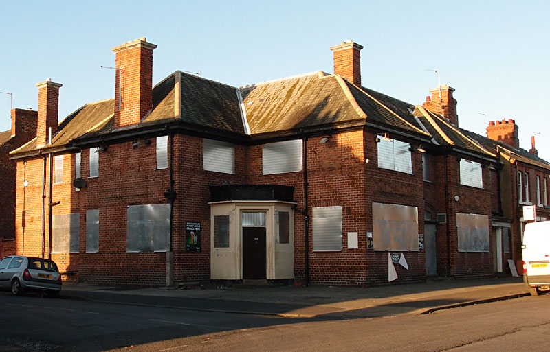 Boarded-up pub