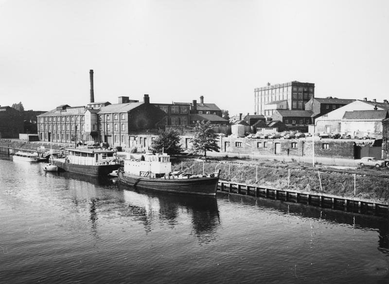 River, factory and barge