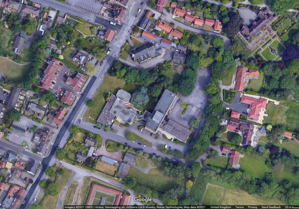 Aerial view of church and adjacent hotel, Dringhouses (Google)