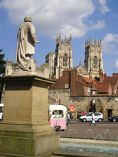 Statue, city square, Minster towers
