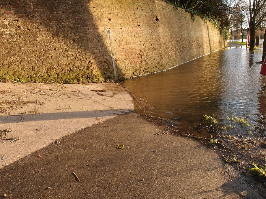 Floodwater, sunlight, wall, tarmac path