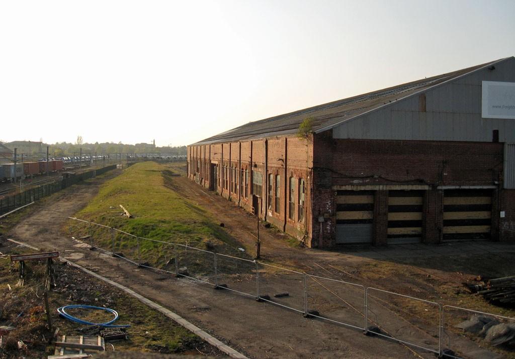 Large 19th century railway workshop in evening sunlight