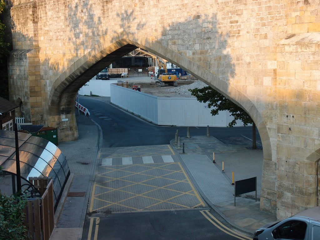 Taken from Queen St bridge, showing the arch in the city walls in Aug 2018. Hudson House development site beyond