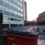 1960s office building. Bin in foreground