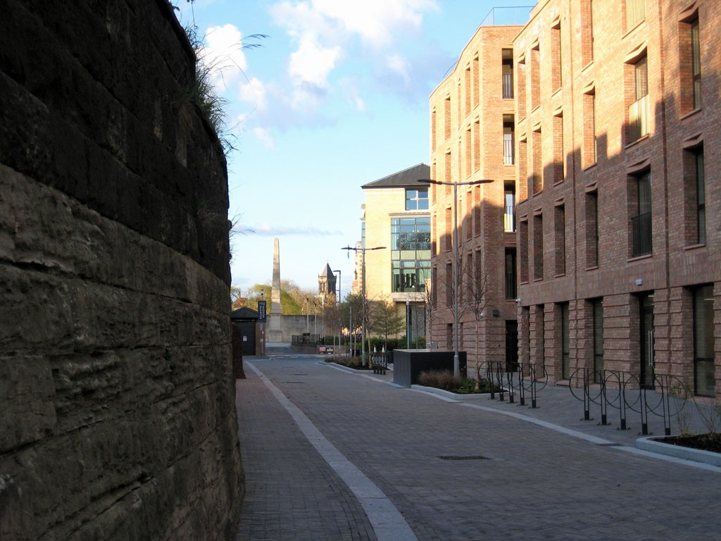 View along road, by new buildings