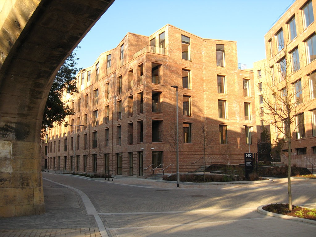 New brick-built apartment blocks framed by archway