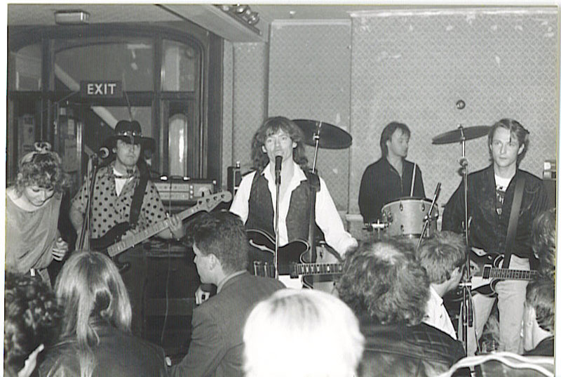 Band playing gig, black and white photo
