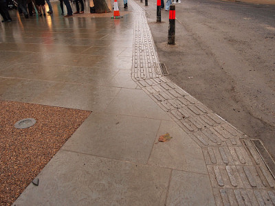 Detail, textured paving to indicate road edge