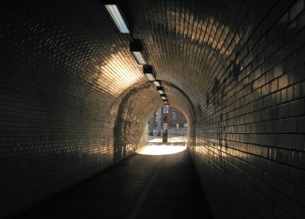 Light at end of glazed brick tunnel