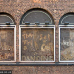 A boxer, a dancer, and a wrestler: SS Empire ghost signs