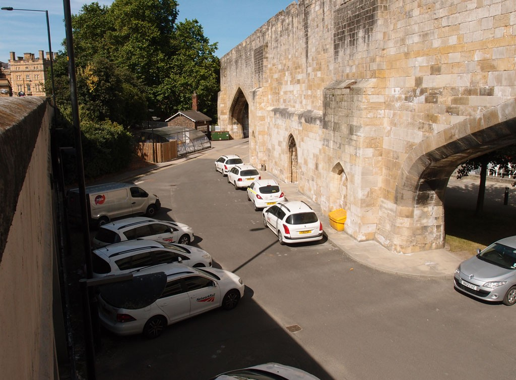 On Queen Street bridge, looking down on the archways cut through the city walls (1 July 2018)