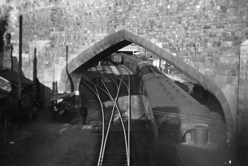 How it used to be around here: taken from Queen St bridge, showing the railway lines still in use through the arches in the city walls (source & more info)