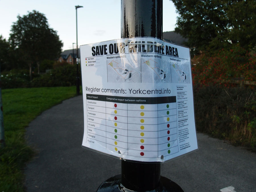 Notice on lamp post: 'Save our wildlife area'