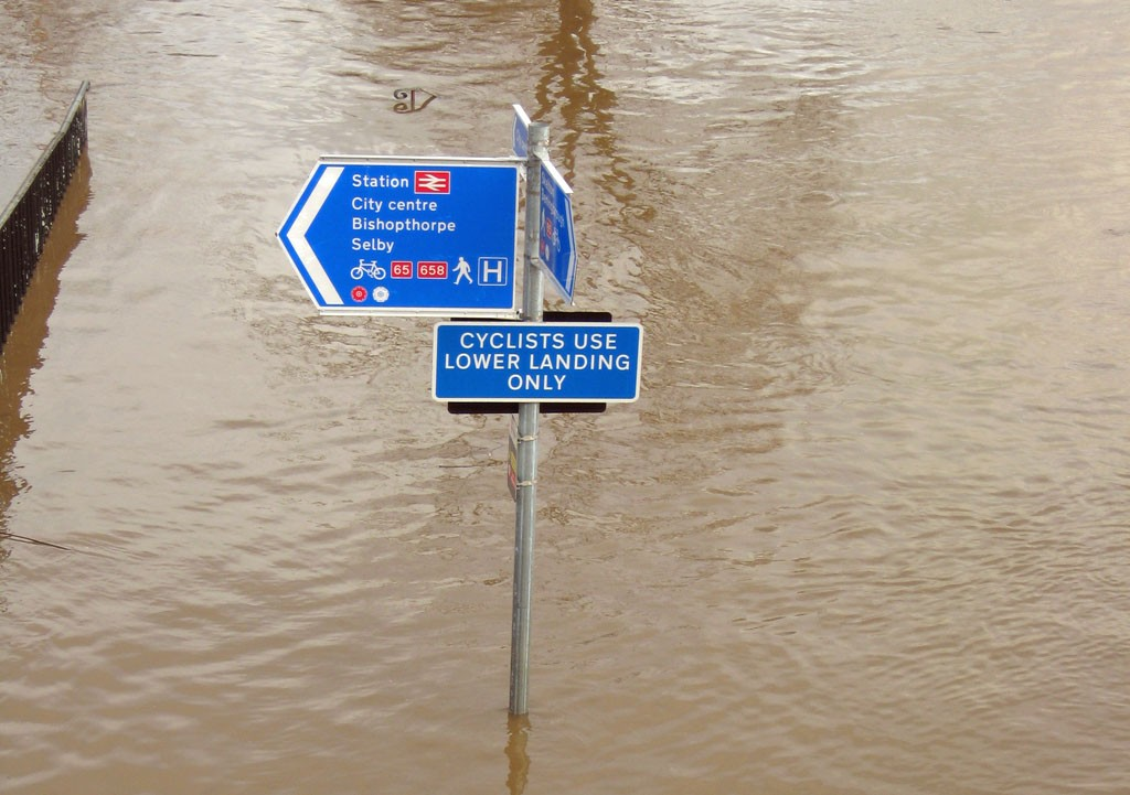 Signposts sticking out of floodwater