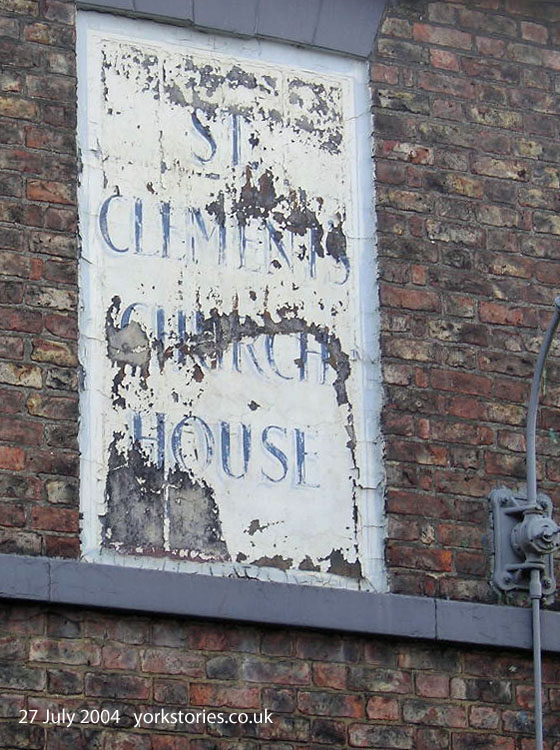 Faded peeling sign for St Clement's Church House, July 2004