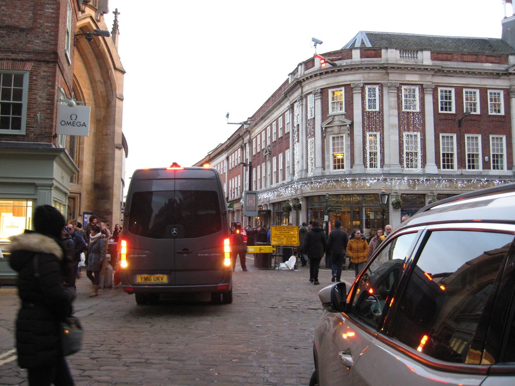 Street scene, vehicles and shoppers