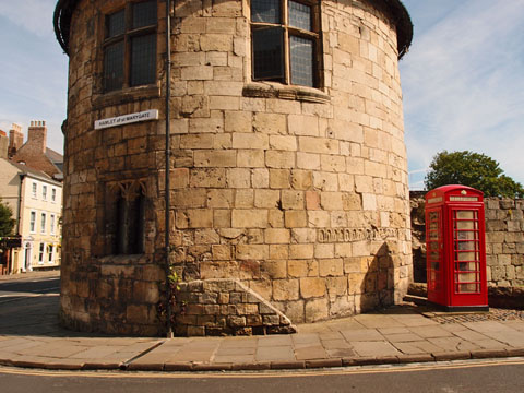 Medieval tower, red phone box