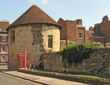 Street scene, medieval tower and wall