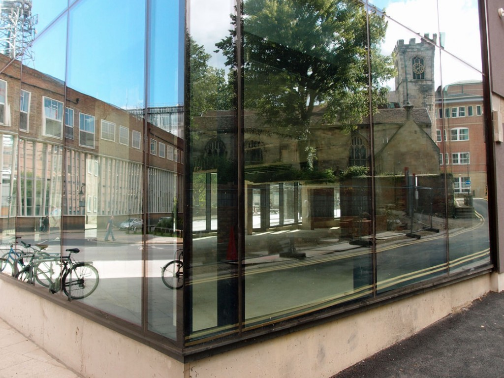 Glass windows showing nearby buildings reflected