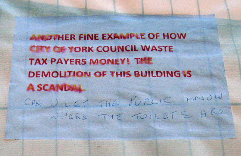 Angry sign about toilets demolition
