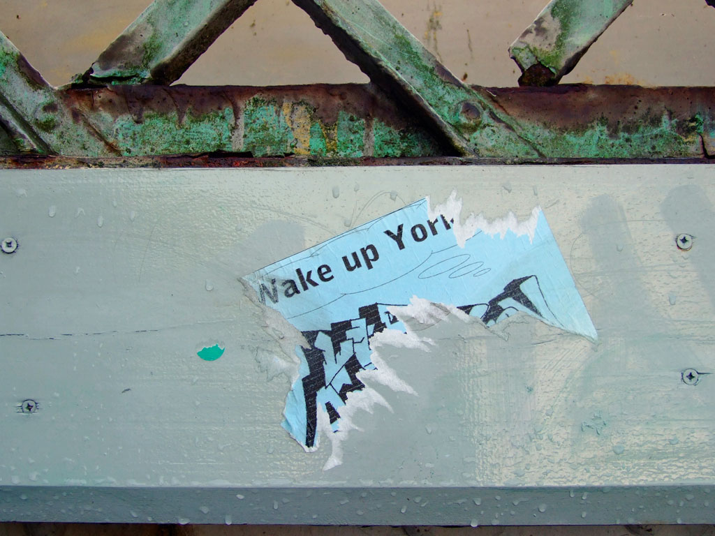 'Wake up York'. Flier/sticker on bridge paintwork