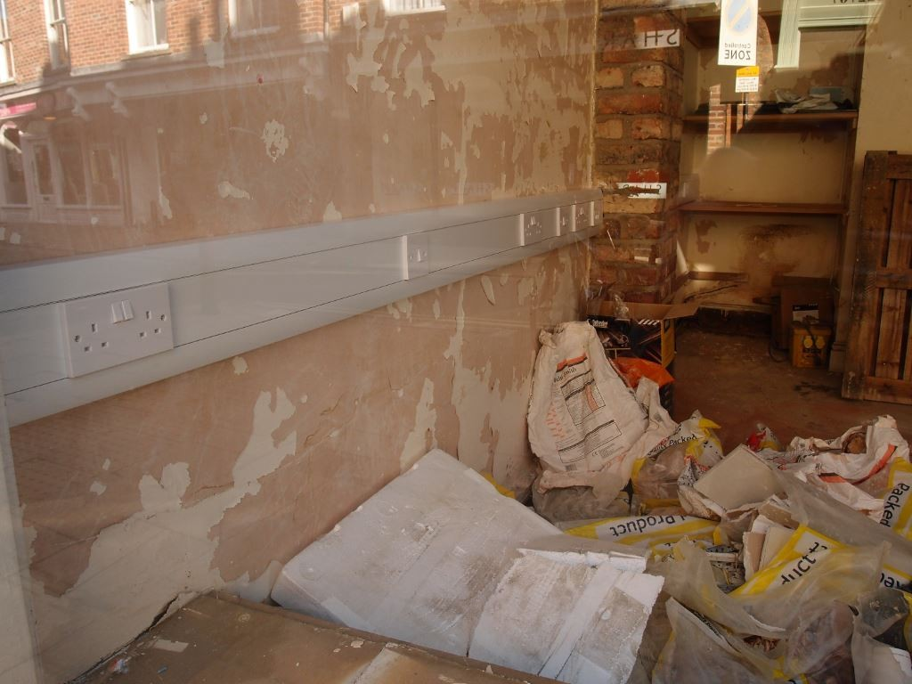 Repairing a Walmgate shop after the floods