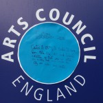 Exhibition Square. (Nice placing in middle of Art Council logo on hoardings!)