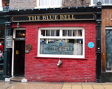 Pub frontage with temporary blue plaque