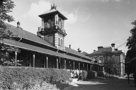 Black and white photo of hospital with verandah